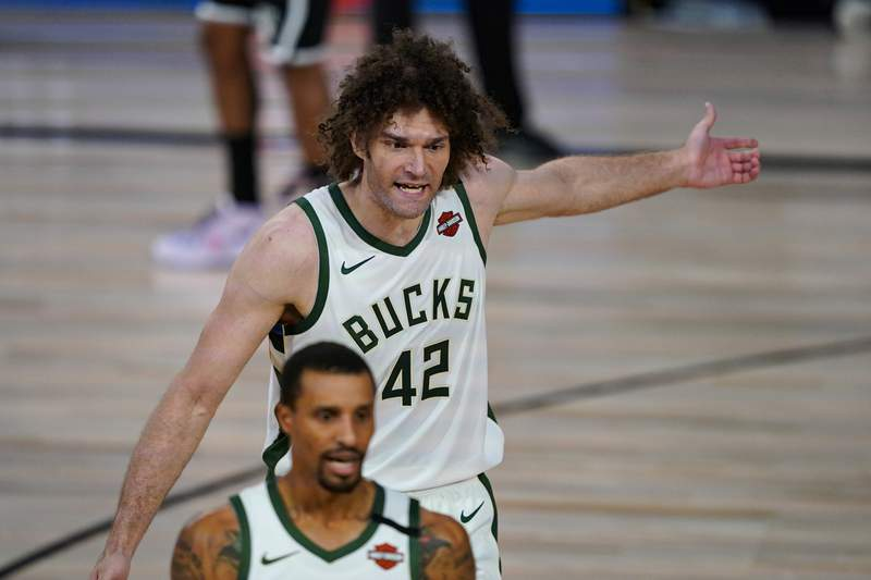 Milwaukee Bucks center Robin Lopez (42) reacts to a call during the first half of an NBA basketball game against the Brooklyn Nets Tuesday, Aug. 4, 2020 in Lake Buena Vista, Fla. (AP Photo/Ashley Landis)