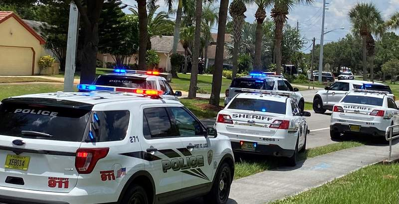 Port St. Lucie say three people are dead, including an 11-year-old girl, after a dispute over a dog.
