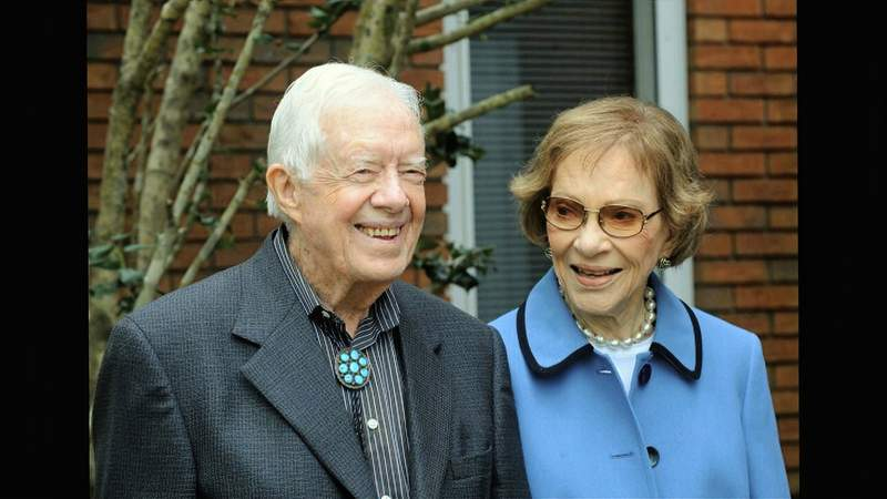 In this image from video, former President Jimmy Carter and former first lady Rosalynn Carter, seen in a photo as they speak on audio only, during the second night of the Democratic National Convention on Tuesday, Aug. 18, 2020. (Democratic National Convention via AP)