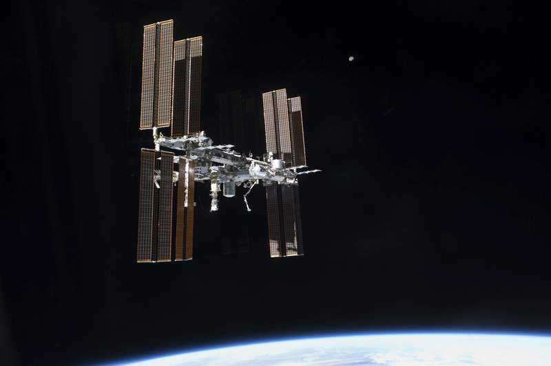 FILE - This July 19, 2011 photo of the International Space Station was taken from the space shuttleAtlantis. On Tuesday, Sept. 29, 2020, NASA said that the two Russians and one American on board were awakened late Monday to hurriedly seal hatches between compartments and search for the ongoing leak, which appeared to be getting worse. It was the third time in just over a month that the crew had to isolate themselves on the Russian side, in an attempt to find the growing leak.  (NASA via AP)