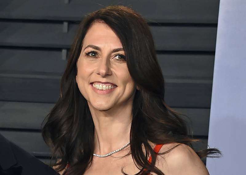 FILE - In this March 4, 2018, file photo, then-MacKenzie Bezos arrives at the Vanity Fair Oscar Party in Beverly Hills, Calif. Galvanized by the racial justice protests and the coronavirus pandemic, charitable giving in the United States reached a record $471 billion in 2020, according to a Giving USA report released Tuesday, June 15, 2021. MacKenzie Scott stormed the philanthropy world in 2020 with $5.7 billion in unrestricted donations to hundreds of charities. The seven- and eight-figure gifts were the largest many had ever received. (Photo by Evan Agostini/Invision/AP, File)
