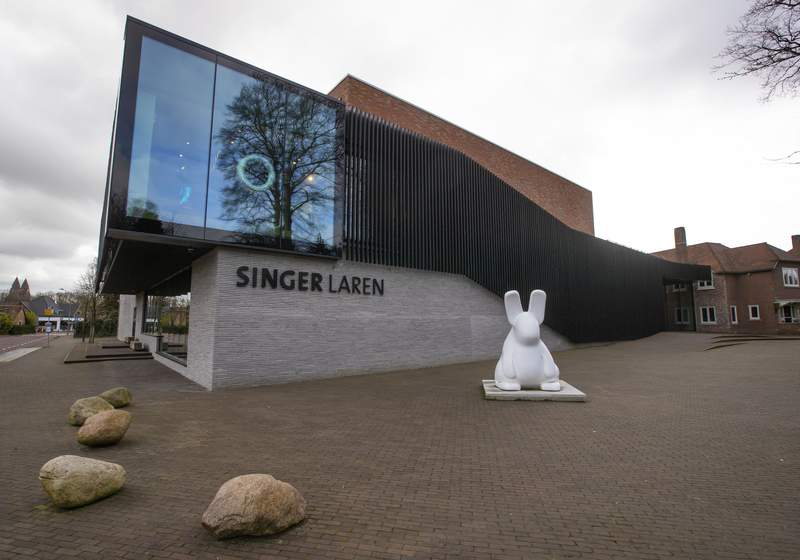 FILE- In this Monday March 30, 2020, file photo, the exterior of the Singer Museum is seen in Laren, Netherlands. A 59-year-old man, described as an incorrigible and calculating criminal was convicted Friday of stealing a painting by Vincent van Gogh and another by Frans Hals from two Dutch museums last year and sentenced to the maximum eight years in prison. The man, whose identity was not released in line with Dutch privacy rules, was found guilty of snatching the Van Gogh painting The Parsonage Garden at Nuenen in Spring 1884 from the Singer Laren museum east of Amsterdam and Two Laughing Boys by Frans Hals that was stolen from the Museum Hofje van Mevrouw van Aerden in Leerdam, 60 kilometers (about 35 miles) south of Amsterdam, , the Central Netherlands Court said in a statement. (AP Photo/Peter Dejong, File)