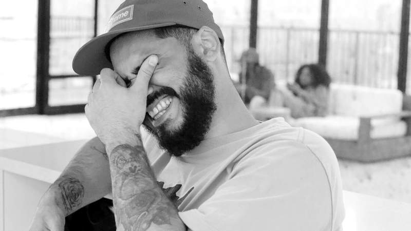A guy laughing.