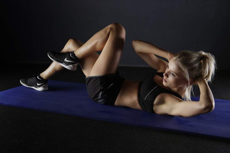 A woman working out.
