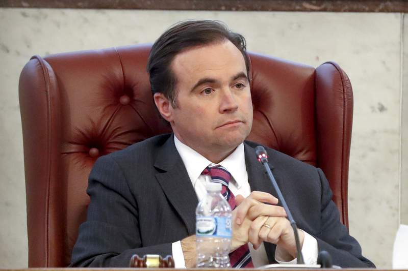 FILE - In this March 21, 2018, file photo, Cincinnati Mayor John Cranley listens during a city council meeting in Cincinnati. Cranley has made it official: he's running to be governor of Ohio. With the launch of his campaign, he joins his friend, Dayton Mayor Nan Whaley, in the Democratic field. (AP Photo/John Minchillo, File)