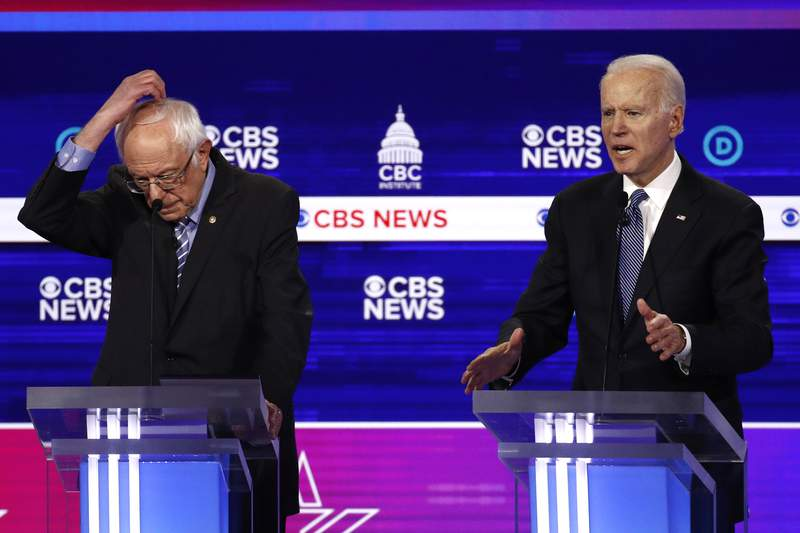 From left, Democratic presidential candidates Sen. Bernie Sanders, I-Vt., and former Vice President Joe Biden, participate in a Democratic presidential primary debate at the Gaillard Center, Tuesday, Feb. 25, 2020, in Charleston, S.C., co-hosted by CBS News and the Congressional Black Caucus Institute. (AP Photo/Patrick Semansky)