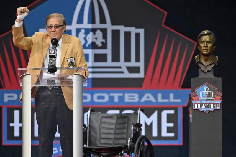 Tom Flores, a member of the Pro Football Hall of Fame Class of 2021, speaks during the induction ceremony at the Pro Football Hall of Fame, Sunday, Aug. 8, 2021, in Canton, Ohio. (AP Photo/David Richard)