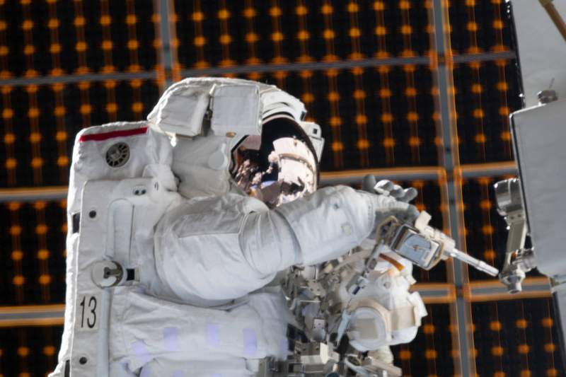 NASA astronaut Jessica Meir is pictured during a spacewalk she conducted with NASA astronaut Christina Koch (out of frame) to install new lithium-ion batteries that store and distribute power collected from solar arrays on the station's Port-6 truss structure. (Photo credit: NASA)