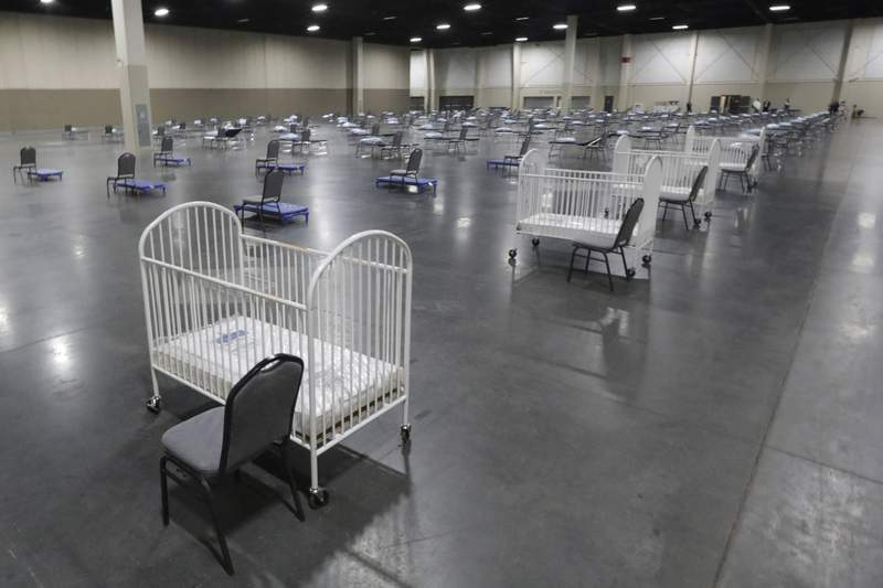 FILE - In this April 6, 2020 file photo, cots and cribs are arranged at the Mountain America Expo Center in Sandy, Utah, as an alternate care site or for hospital overflow amid the COVID-19 pandemic. Although there has been a decline in births in the U.S. during the pandemic, a new report released Tuesday, Sept. 21, 2021 by the U.S. Census Bureau suggests the drop may have turned a corner as births started rebounding last March. (AP Photo/Rick Bowmer, file)