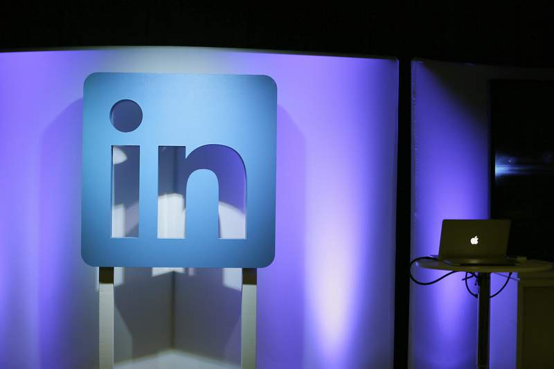 FILE - In this Thursday, Sept. 22, 2016, file photo, the LinkedIn logo is displayed during a product announcement in San Francisco.  Microsoft says it is shutting down its LinkedIn service in China later this year following tighter government censorship rules. The company said in a blog post Thursday, Oct. 14, 2021,  it has faced a significantly more challenging operating environment and greater compliance requirements in China.  (AP Photo/Eric Risberg, File)