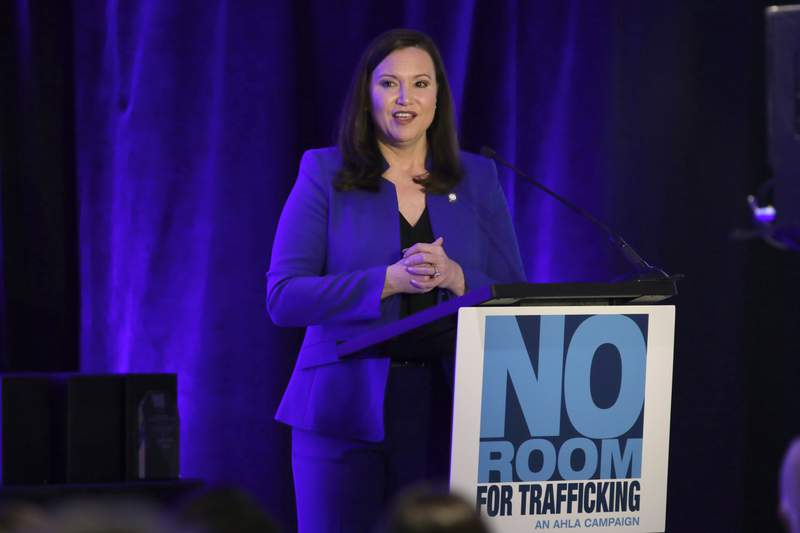 Florida Attorney General Ashley Moody speaks during a meeting between law enforcement officials and hotel groups to announce a campaign to prevent human trafficking surrounding next month's Super Bowl NFL football game in the Miami area, Thursday, Jan. 9, 2020, in Miami Beach, Fla. (AP Photo/Lynne Sladky)