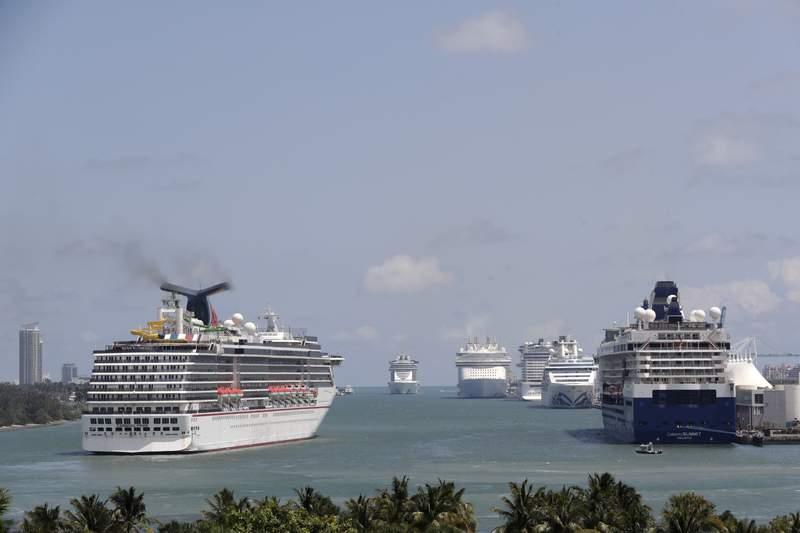The Carnival Pride cruise ship arrives at PortMiami, Tuesday, April 7, 2020, in Miami.  A cruise ship industry group says on Tuesday, Nov. 3,  its members are extending the suspension of U.S. sailing operations through the end of the year, just days after the U.S. government effectively lifted its no-sail order despite a global spike in coronavirus infections. Cruise Lines International Association said its members will use the rest of the year to implement measures to address COVID-19 safety.  (AP Photo/Lynne Sladky)