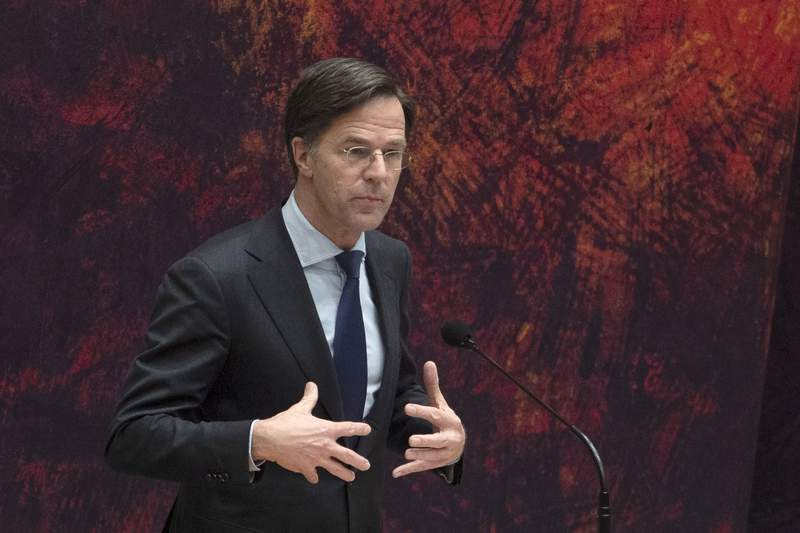 FILE  - In this Friday, April 2, 2021 file photo, caretaker Dutch Prime Minister Mark Rutte apologizes to other party leaders during a debate in parliament in The Hague, Netherlands. The Netherlands appeared to be heading toward talks to form a minority coalition after efforts to piece together a Cabinet made up of five parties from across the political spectrum broke down Tuesday, Aug. 31, 2021. (AP Photo/Peter Dejong, FIle)