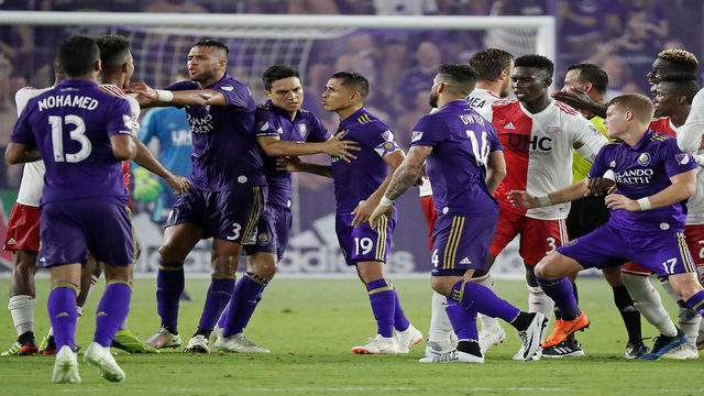 Players get into a scuffle during the second half of an MLS soccer match between Orlando City and the New England Revolution, Saturday, Aug. 4, 2018, in Orlando, Fla. (AP Photo/John Raoux)
