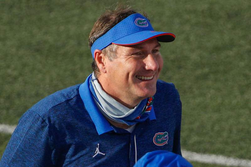 NASHVILLE, TENNESSEE - NOVEMBER 21: Head coach Dan Mullen of the Florida Gators addresses his team after a victory over the Vanderbilt Commodores at Vanderbilt Stadium on November 21, 2020 in Nashville, Tennessee. (Photo by Frederick Breedon/Getty Images)