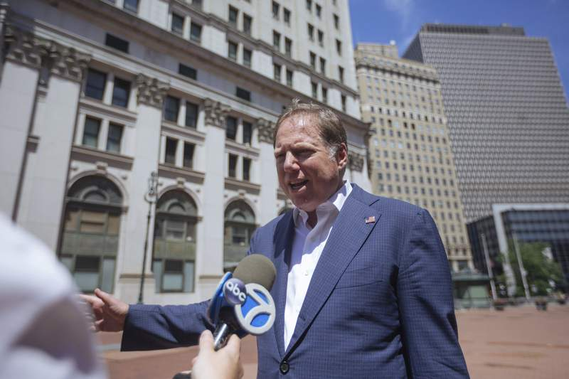 FILE - In this June 20, 2020, file photo, Geoffrey S. Berman, then-U.S. attorney for the Southern District of New York, speaks to reporters as he arrives to his office in New York. The ousted former U.S. attorney for Manhattan will sit down with the House Judiciary Committee next week for a closed-door interview as the panel investigates politicization in the Justice Department (AP Photo/Kevin Hagen, File)