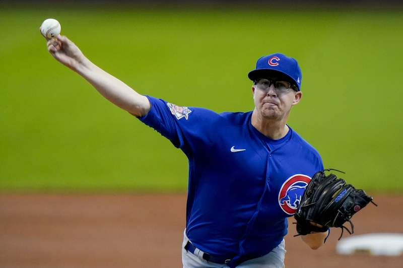 Chicago Cubs starting pitcher Alec Mills throws during the first inning of a baseball game against the Milwaukee Brewers Sunday, Sept. 13, 2020, in Milwaukee. (AP Photo/Morry Gash)