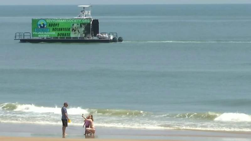 Barge displaying advertisements sets sail in Volusia County