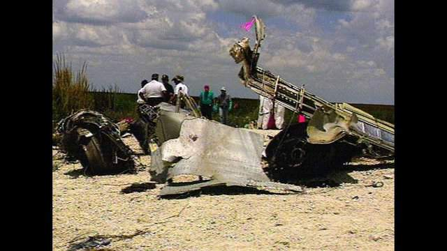 This is a video image of one of the wing from the ill-fated ValuJet flight 592 that was pulled from the Florida Everglades Thursday afternoon, May 16, 1996. The ValuJet DC-9 crashed into the Everglades Saturday, May 11, 1996, killing all aboard. (AP Photo/Metro Dade Fire Rescue, Roman Bas, POOL)
