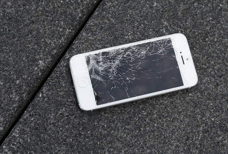 FILE - This Aug. 26, 2015 photo shows an Apple iPhone with a cracked screen after a drop test from the DropBot, a robot used to measure the sustainability of a phone to dropping, at the offices of SquareTrade in San Francisco.   Responding to a new competition directive from the Biden White House, Wednesday, July 21, 2021,  the Federal Trade Commission is moving toward writing new rules aimed at helping small repair businesses and saving consumers money on repair costs. Unavailable parts, instruction manuals, design restrictions and locks on software have made many consumer products harder to fix, regulators say. (AP Photo/Ben Margot, File)
