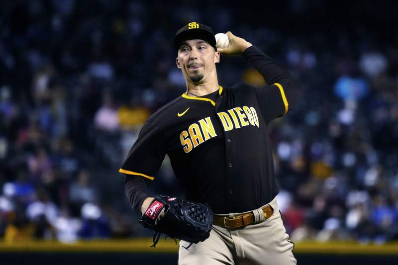 San Diego Padres pitcher Blake Snell throws to an Arizona Diamondbacks batter during the first inning of a baseball game Tuesday, Aug. 31, 2021, in Phoenix. (AP Photo/Rick Scuteri)