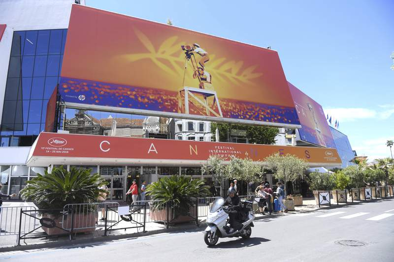 FILE - This May 13, 2019 file photo shows a view of the Palais des festivals during the 72nd international film festival, Cannes, southern France. The Cannes Film Festival on Tuesday, April 14, 2020, abandoned plans for a postponed 2020 edition in June or July but declined to give up entirely, saying it will explore other options. (Photo by Arthur Mola/Invision/AP, File)