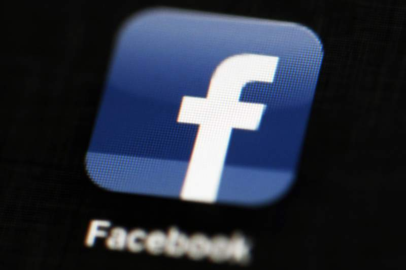 FILE - This May 16, 2012 file photo shows the Facebook app logo on a mobile device in Philadelphia. On Monday, Oct. 12, 2020, Facebook announced it is banning posts that deny or distort the Holocaust and will start directing people to authoritative sources if they search for information about the Nazi genocide. (AP Photo/Matt Rourke, File)