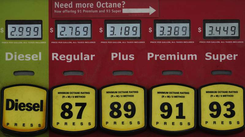 In this March 16, 2021 photo, a gas pump displays gas and diesel prices in Richmond, Va.  Gasoline prices are at a seven-year high, Thursday, May 27,  ahead of one of Americas busiest holiday travel weekends. But experts dont expect steep prices to keep eager motorists off the road.     (AP Photo/Steve Helber)