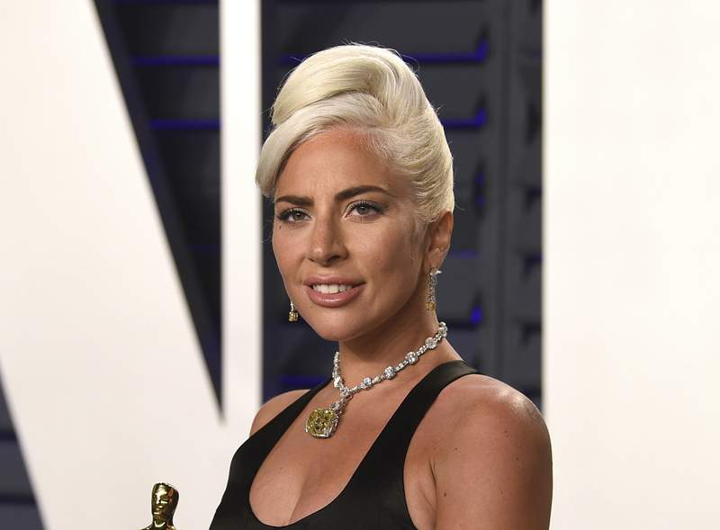 """FILE - Lady Gaga, winner of the award for best original song """"Shallow,"""" arrives at the Vanity Fair Oscar Party on Sunday, Feb. 24, 2019, in Beverly Hills, Calif. The South Korean boy band BTS HAS won a leading four awards including best song for Dynamite and best group at the MTV Europe Music Awards Sunday, Nov. 8, 2020 while Lady Gaga took home the best artist prize.(Photo by Evan Agostini/Invision/AP, File)"""