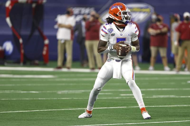Florida quarterback Emory Jones (5) looks to throw against Oklahoma during the NCAA Cotton Bowl college football game Wednesday, Dec.30, 2020, in Arlington, Texas. (AP Photo/Ron Jenkins)