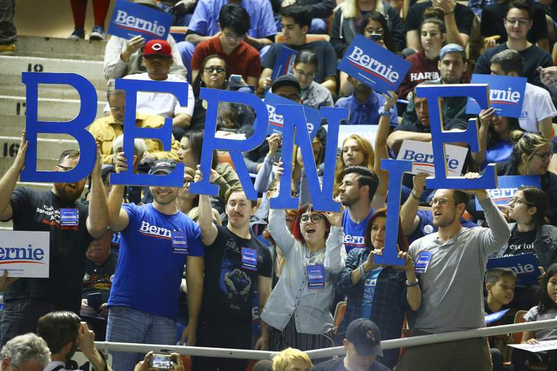 Supporters of Democratic presidential candidate Sen. Bernie Sanders, I-Vt., cheer as they wait for a rally to begin Thursday, March 5, 2020, in Phoenix. (AP Photo/Ross D. Franklin)
