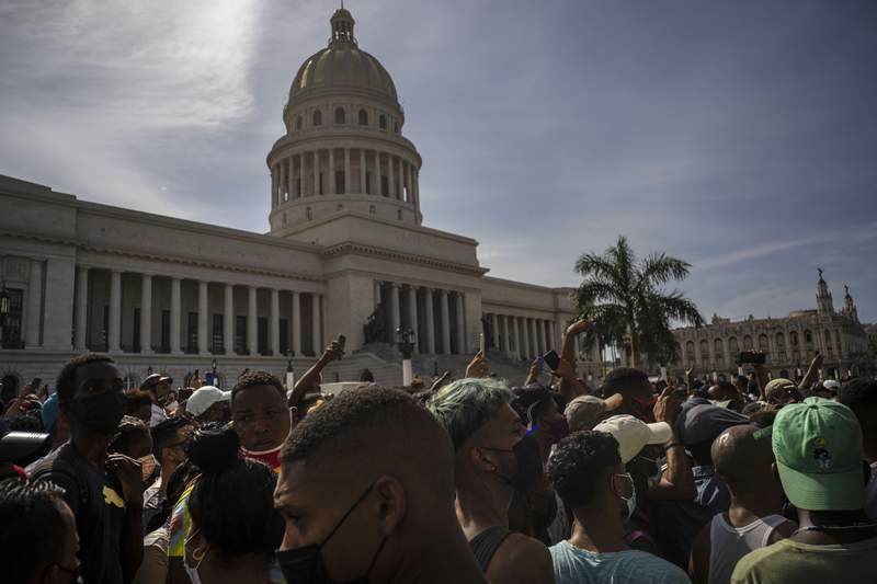 FILE - In this July 11, 2021 file photo, people protest in front of the Capitol in Havana, Cuba. A report released Wednesday, July 21,  shows philanthropic funding to promote global human rights reached a record $3.7 billion in 2018. The report by the philanthropy research organization Candid and Human Rights Funders Network says nearly half of the donations came from 12 foundations and most of the contributions were earmarked for programs in North America.  (AP Photo/Ramon Espinosa, File)
