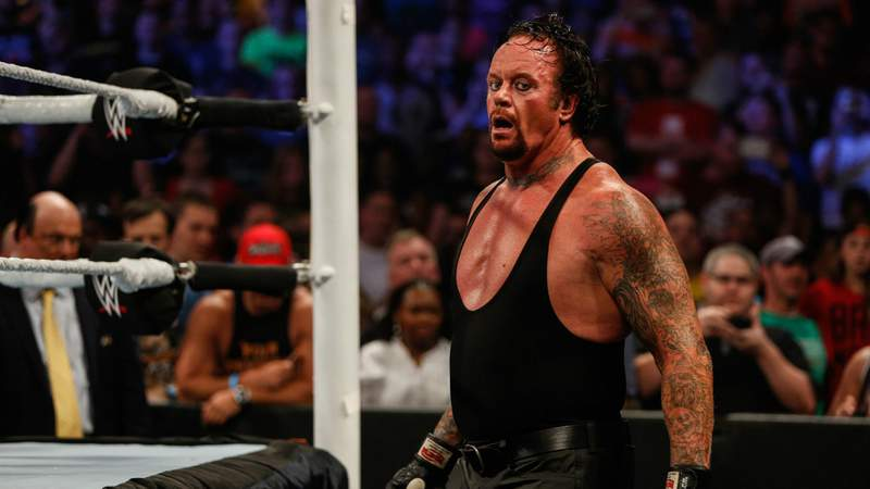 The Undertaker recovers during his fight against Brock Lesner at the WWE SummerSlam 2015 at Barclays Center of Brooklyn on August 23, 2015 in New York City. (Photo by JP Yim)