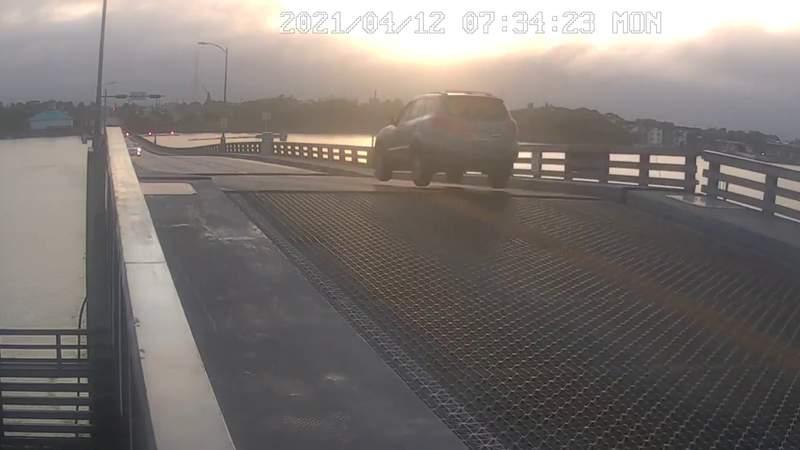 VIDEO: SUV seen jumping Main Street Bridge