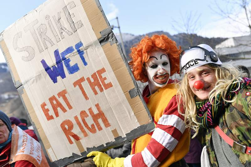 Participants of the climate protest march gather at the train station in Landquart, Switzerland, Sunday, Jan. 19, 2020. Around 500 activists came together to hike the 40 kilometers to Davos to protest against climate change and global warming next Tuesday. (Walter Bieri/Keystone via AP)