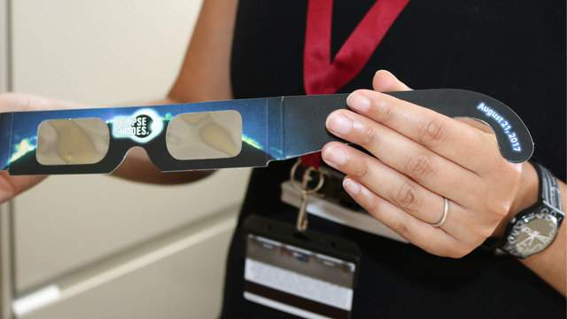 Florida Institute of Technology stellar scientists Saida Caballero-Nieves holds a pair of solar glasses with Mylar film. Florida Tech will host a solar eclipse viewing party at the Olin Physical Science Building on Aug. 21, 2017.