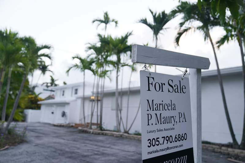 A waterfront home is shown for sale, Thursday, Oct. 7, 2021, in Surfside, Fla. Average long-term mortgage rates declined this week, with the benchmark 30-year loan slipping back below 3%. (AP Photo/Wilfredo Lee)