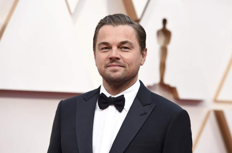 FILE - In this Feb. 9, 2020, file photo, Leonardo DiCaprio arrives at the Oscars in Los Angeles. DiCaprio is helping to launch the $12 million Americas Food Fund aimed at helping low-income families, the elderly and those whose jobs have been disrupted by the coronavirus pandemic. Among those teaming up for the launch are philanthropist Laurene Powell Jobs, Apple and the Ford Foundation. (Photo by Jordan Strauss/Invision/AP, File)