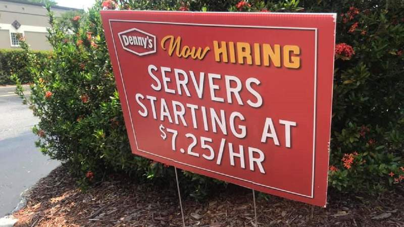 A now hiring sign posted outside a Denny's in the International Drive area of Orlando.