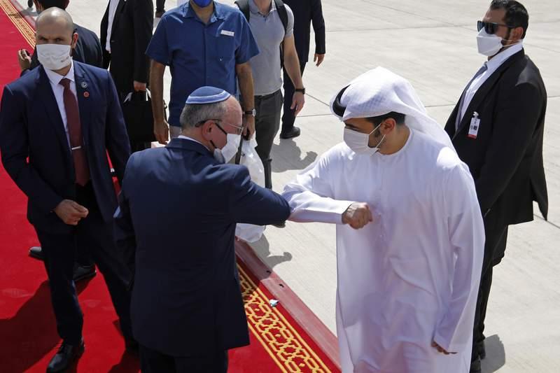 Israeli National Security Advisor Meir Ben-Shabbat, center left, elbow bumps with an Emirati official as he leaves Abu Dhabi, Arab Emirates, Tuesday, Sept. 1, 2020. (Nir Elias/Pool via AP)