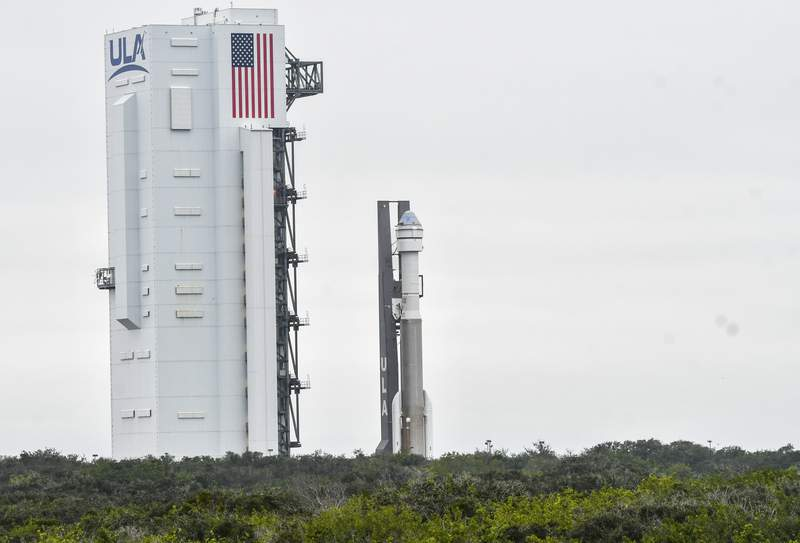 A United Launch Alliance Atlas V rocket rolls out to the pad at Cape Canaveral Air Force Station Wednesday, Dec. 18. 2019. Atop the rocket is Boeing's Starliner capsule, scheduled to lift off Friday morning on a test flight to the International Space Station. (Craig Bailey/Florida Today via AP)