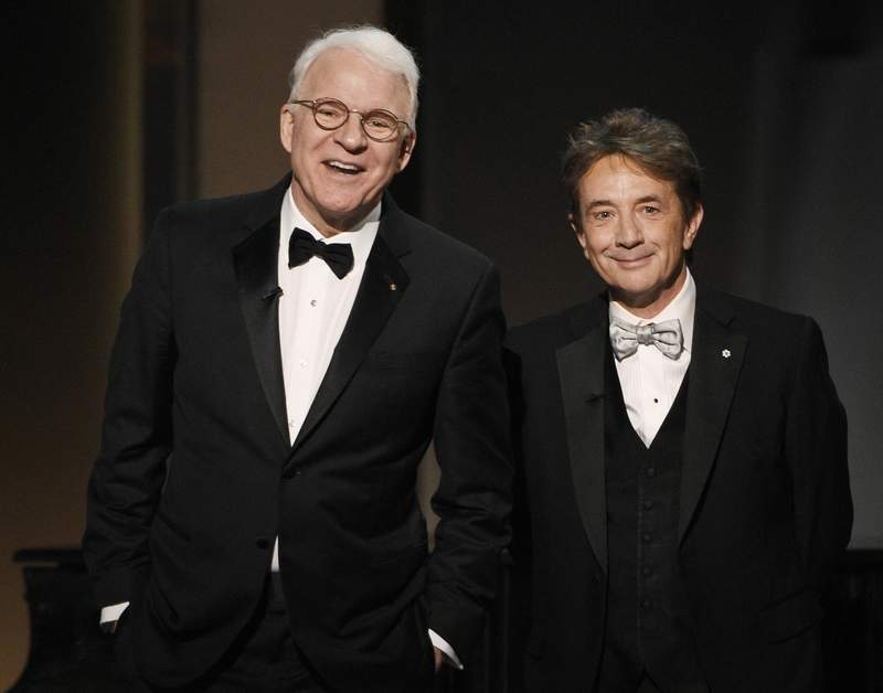 FILE - In this June 8, 2017 file photo, Steve Martin, left, and Martin Short appear at the 45th AFI Life Achievement Award Tribute to Diane Keaton in Los Angeles.  Steve Martin and Martin Short are taking their touring act to television with a new Hulu comedy. The untitled show about three strangers who share an obsession with true crime and suddenly find themselves wrapped up in one was announced Friday, Jan. 17, 2020 at a TV critics meeting.  (Photo by Chris Pizzello/Invision/AP, File)