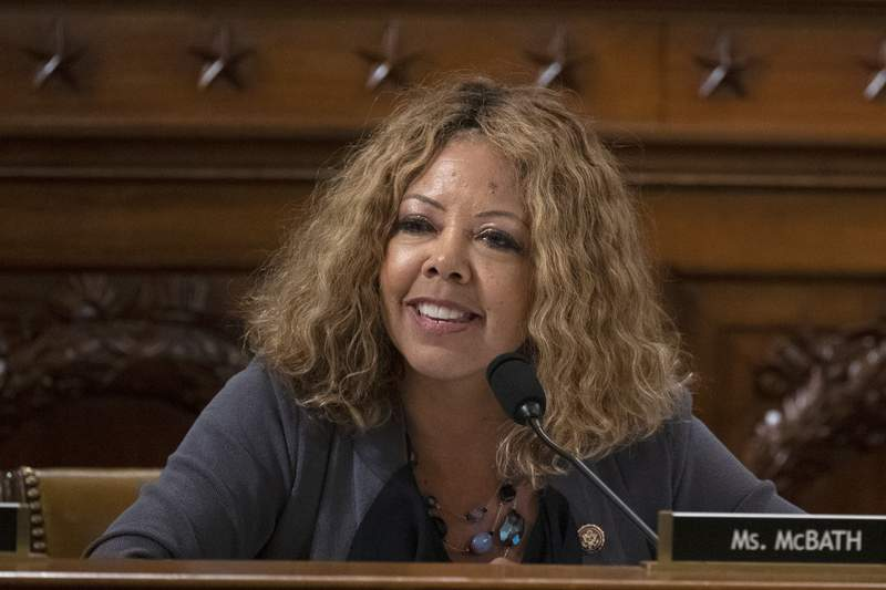 U.S. Rep. Lucy McBath, shown in a Thursday Dec. 12, 2019 file photo on Capitol Hill in Washington, is seeking re-election in suburban Atlantas 6th Congressional District. She debated Tuesday with her general election opponent, Republican Karen Handel, who McBath narrowly beat in 2018 to claim the seat in an affluent district that includes parts of Cobb, Fulton and DeKalb counties. (Alex Edelman/Pool via AP)