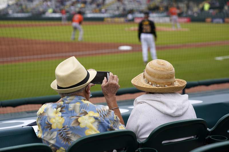 FILE - In this Monday, March 22, 2021 file photo, elderly socially distanced baseball fans watch a spring training exhibition baseball game between the Pittsburgh Pirates and the Baltimore Orioles in Bradenton, Fla. Spring has arrived with sunshine and warmer temperatures, and many vaccinated seniors are emerging from COVID-19-imposed hibernation. (AP Photo/Gene J. Puskar, File)