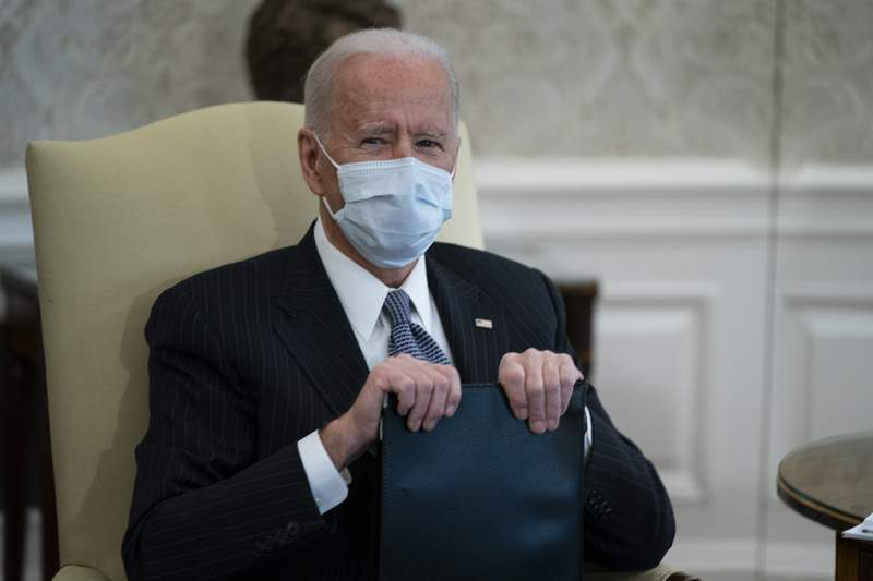 President Joe Biden meets with Senate Majority Leader Sen. Chuck Schumer of N.Y., and other Democratic lawmakers to discuss a coronavirus relief package, in the Oval Office of the White House, Wednesday, Feb. 3, 2021, in Washington. (AP Photo/Evan Vucci)