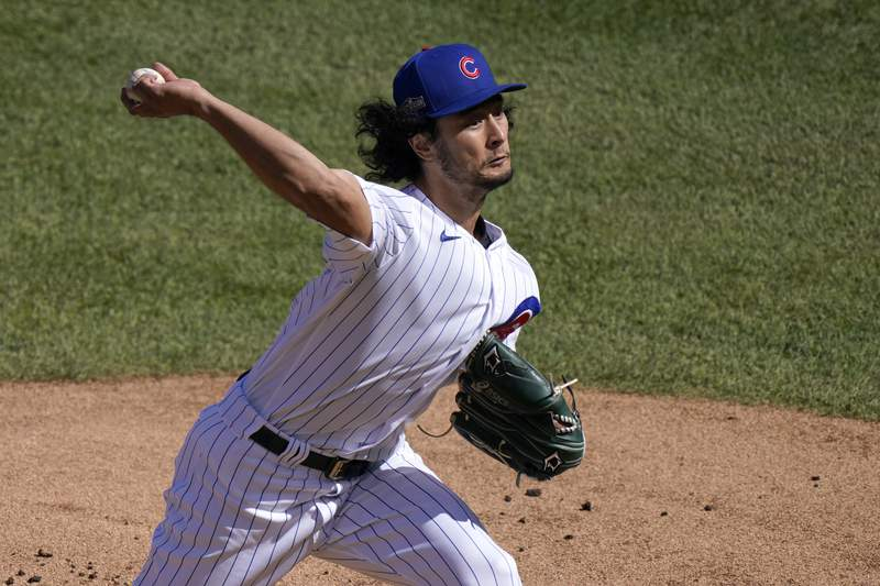 FILE - In this Oct. 2, 2020, file photo, Chicago Cubs starting pitcher Yu Darvish throws during the first inning in Game 2 of the team's NL wild-card baseball series against the Miami Marlins in Chicago. The San Diego Padres traded for another big arm on Tuesday night, Dec. 29, acquiring Darvish in a blockbuster deal with the Cubs. The Padres got Darvish, catcher Victor Caratini and cash from the Cubs for right-hander Zach Davies and four young minor leaguers. (AP Photo/Nam Y. Huh, File)
