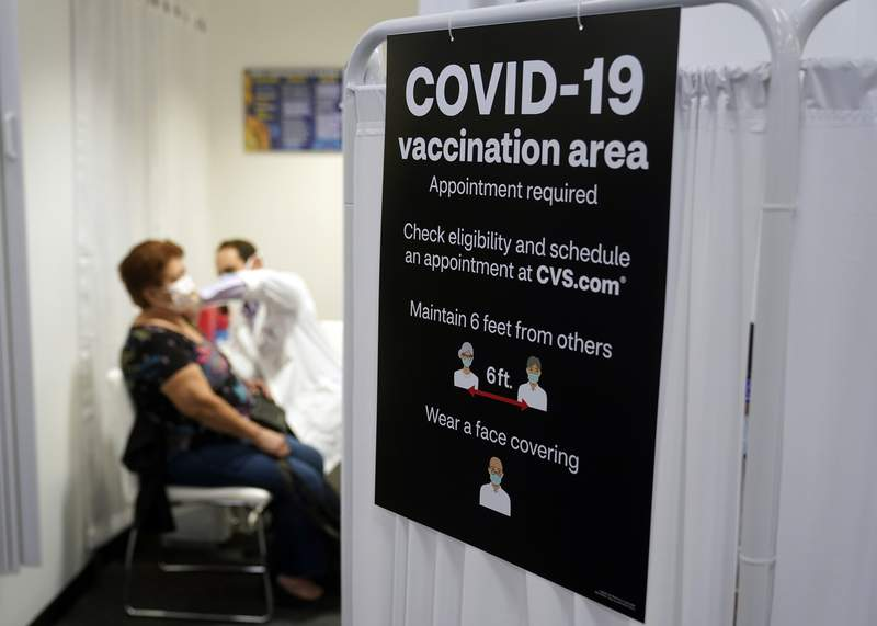 FILE - In this March 1, 2021, file photo, a patient receives a shot of the Moderna COVID-19 vaccine at a CVS Pharmacy branch in Los Angeles.  (AP Photo/Marcio Jose Sanchez, File)