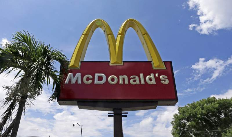 """FILE - This June 28, 2016, file photo shows a McDonald's sign in Miami. A few McDonalds workers in Florida are filing a $500 million class action lawsuit against the company, claiming a """"systemic sexual harassment problem"""" at company-owned stores. The lawsuit was filed Monday, April 13, 2020, in federal court in Illinois. (AP Photo/Alan Diaz, File)"""