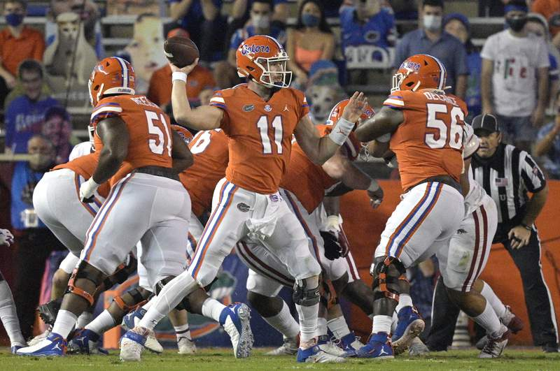 Florida quarterback Kyle Trask (11) throws a pass during the first half of an NCAA college football game, Saturday, Nov. 14, 2020, in Gainesville, Fla. (AP Photo/Phelan M. Ebenhack)