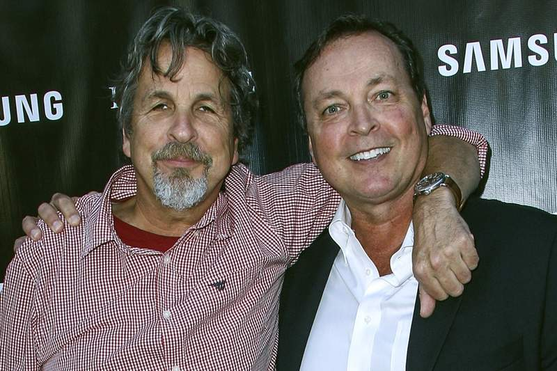 """FILE - In this Aug. 10, 2015 file photo, Peter Farrelly, left, and Bobby Farrelly attend The Project Greenlight Season 4 premiere of """"The Leisure Class"""" at The Theatre At The Ace Hotel in Los Angeles. The Boston-based Ruderman Family Foundation said Wednesday, Dec. 4, 2019, that the brothers are recipients of its sixth annual Morton E. Ruderman Award in Inclusion for pressing Hollywood to do a better job of casting and portraying people with disabilities. (Photo by Paul A. Hebert/Invision/AP, File)"""